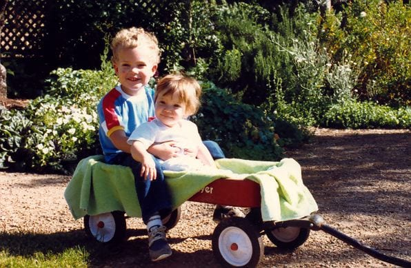 Lorenzo and Hailey enjoying their Radio Flyer as they are towed in the vineyard garden